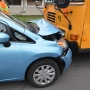 Car crashes into school bus, one student has minor injury